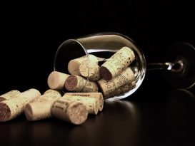 wine glass with corks inside