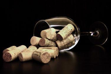 wine glass with corks inside